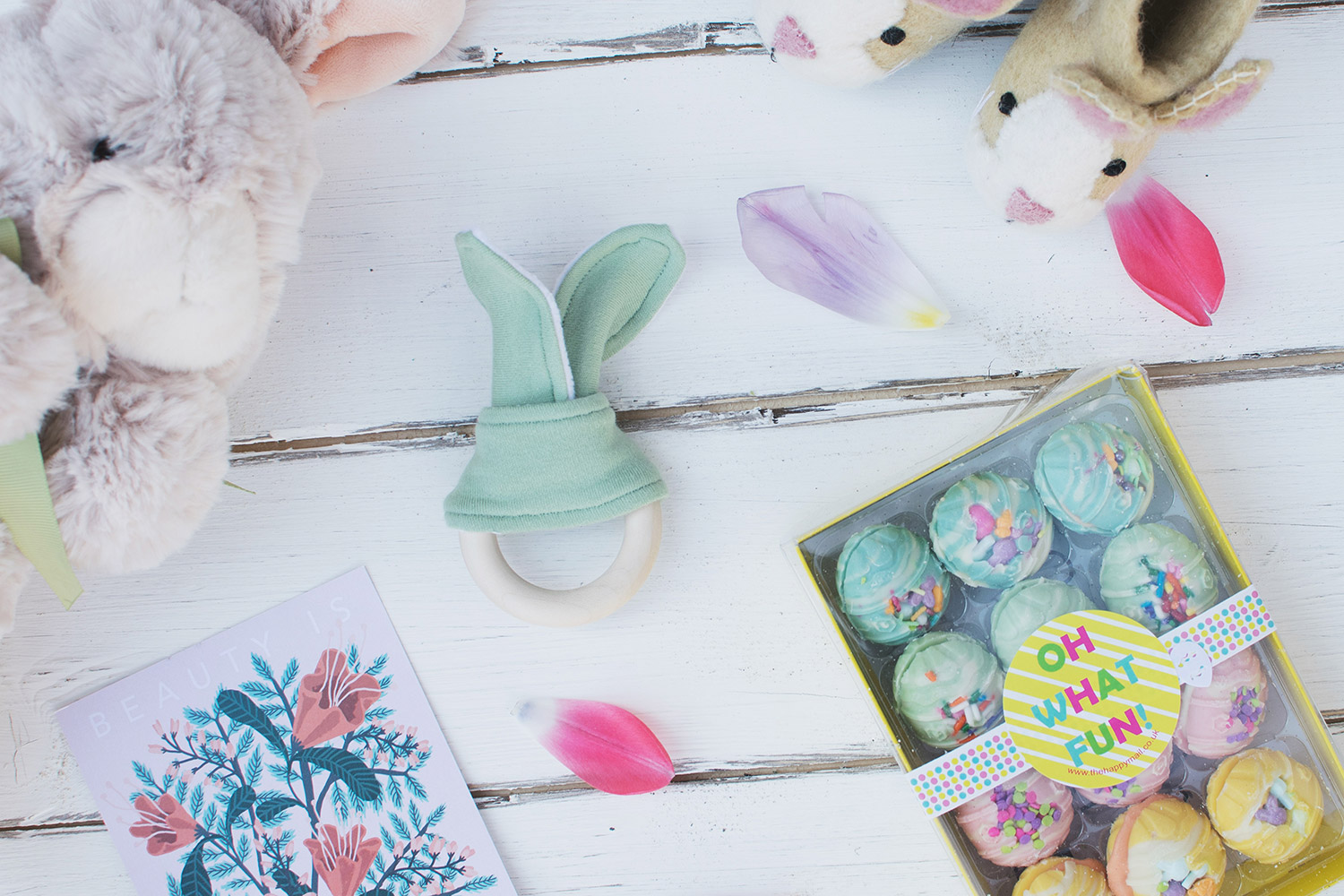 Happy Easter! Fancy more chocolate? (Of course you do) - Giveaway of an Easter hamper featuring a Blue Bunny Boutique wooden teething ring, Happy Mail funfetti chocolate eggs, Sew Heart Felt bunny slippers and Harrods soft toy bunny rabbit