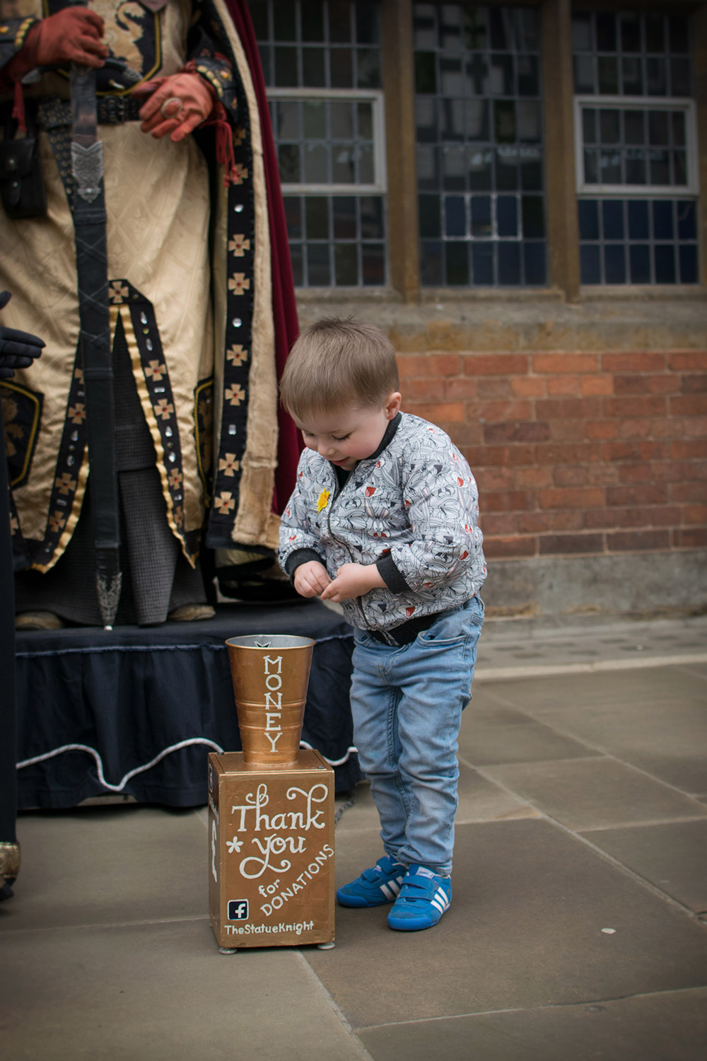 Tween boy posing with the Shakespeare street actors in Stratford-upon-Avon on a day out with family